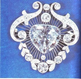 The Cullinan V Heart Brooch - the centre stone is the 18.8 carat heart-shaped Cullinan V diamond. The platinum setting & the positioning of the collets in the brooch were all expressly designed to accentuate the shape of the stone. It was made for Queen Mary in 1910.
