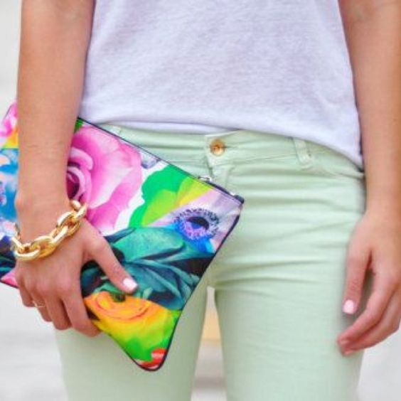 Light green pants. Floral clutch
