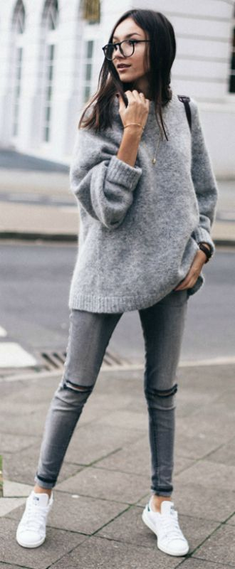 Beatrice Gutu wears grey skinny jeans with a rolled up sweater and white sneakers.   Sweater: H&M, Jeans: Forever21, Sneakers: Stan Smith.