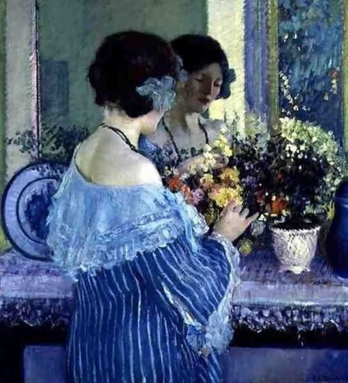 Girl in Blue Arranging Flowers, Frederick Carl Frieseke. American Impressionist Painter (1874 - 1939)