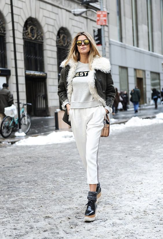 Pin for Later: The Street Style Hot Enough to Make You Forget the Cold NYFW Day Six Martha Graeff wearing a Balenciaga jacket, Topshop pants, Stella McCartney shoes and a Coach bag