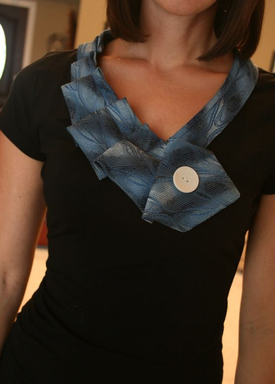 I made this out of a Target $6 t-shirt and one of my grandpa's old ties... Cute and easy!