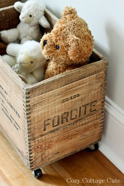 Cozy.Cottage.Cute. totally into these crates on castors for toy storage.