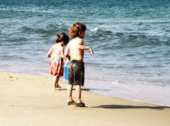 Children Playing at the Beach, photography by Cassandra Donnelly.