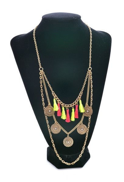 You'll look like a persian goddess in this triple layered neckalce! Between the antique gold, coin like accents & pink and neon green tassels it's the perfect necklace!