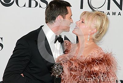 © Laurence Agron   Dreamstime.com- Australian Hugh Jackman is poised to kiss wife Deborra-Lee Furness, likewise from Oz as they celebrate his special award at the 66th Annual Tony Awards in New York City on June 10, 2012.