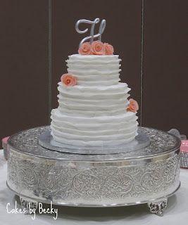 White ruffled wedding cake with modeling chocolate roses <3