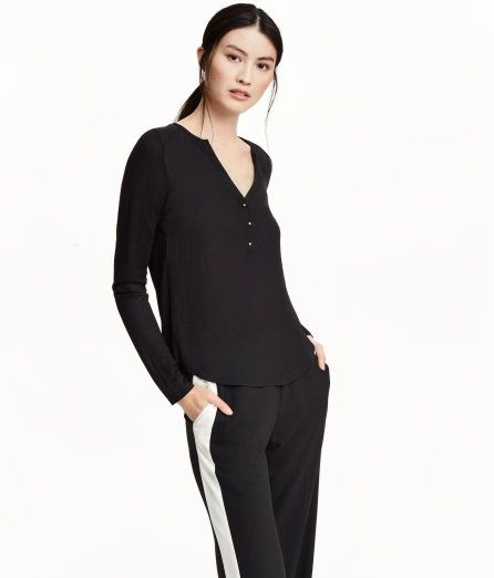 Check this out! V-neck blouse with front section in lightly creped, woven fabric and jersey back section with a sheen. Long sleeves and a short button placket. - Visit hm.com to see more.