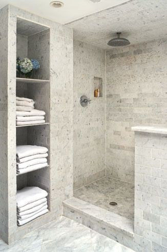 Walk in shower love the open place for towels                              …