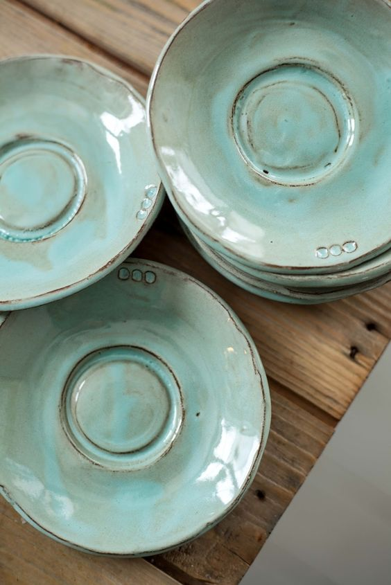 Muted teal saucers.