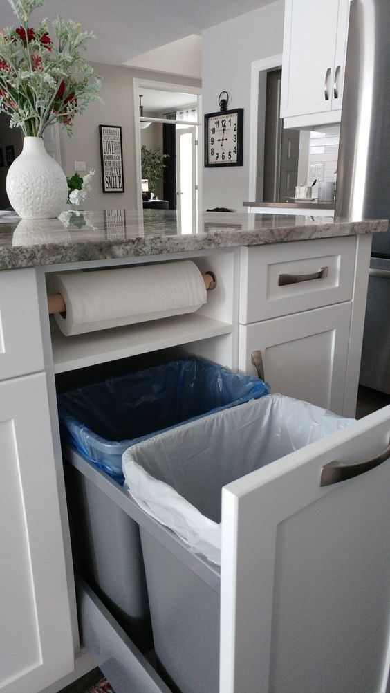 Kitchen storage idea. Garbage, recycling, and paper towels neatly tucked away.