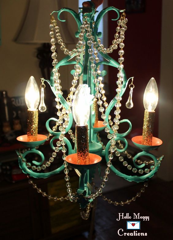 Beautiful teal-aqua painted chandelier, with peach-pink and gold glitter accents and clear beading. Chandelier has a very long cord and silver colored chain for hanging.  Chandelier itself is 15 x 10 inches, light bulbs not included