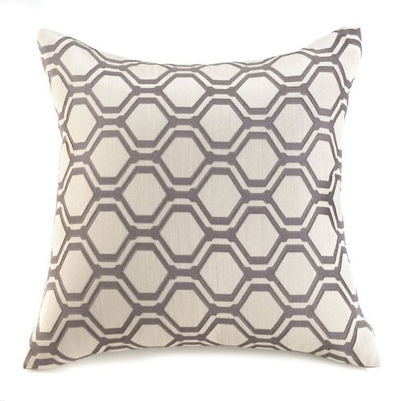 This geometric-inspired throw pillow has uptown class with downtown appeal. Taupe hexagons embroidered on a natural cushion are the key to unlocking your room's style potential. Hexagon Geometric Throw Pillow by Rustica House. #myRustica