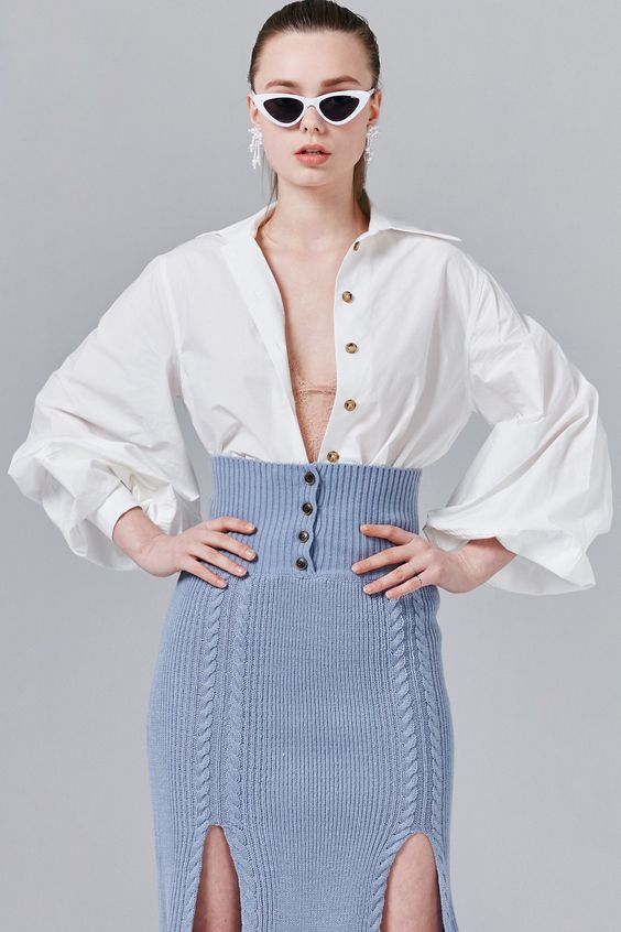 "Details Balloon sleeves add drama to a classic button-up shirt. - Contrasting buttons - Point collar, long balloon sleeves - Front button fastening - Comes in two colors: White / Skyblue Content + Care - 100% Cotton - Dry clean Size + Fit Model is 5'8"" and wearing size One size"