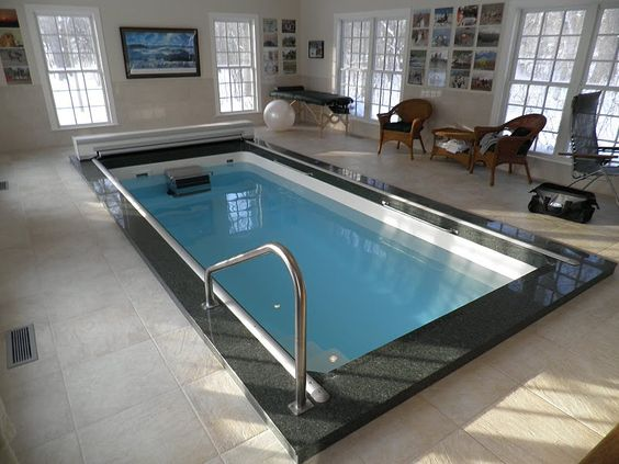 Swim at home year round with an indoor fiberglass endless for Saltwater endless pool
