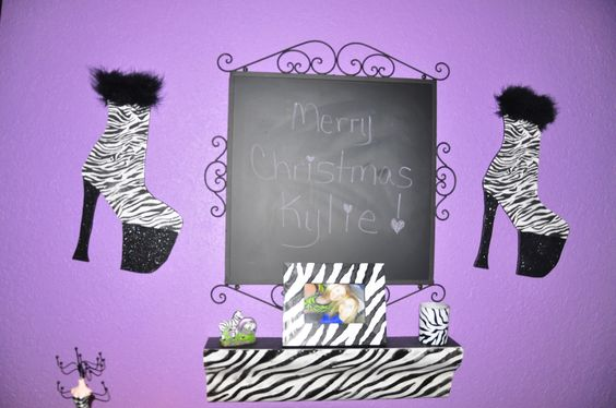 This is main wall. Shoes are wood cut out by Jason Swafford then I painted and decorated! Got chalk board and shelf at Hobby Lobby
