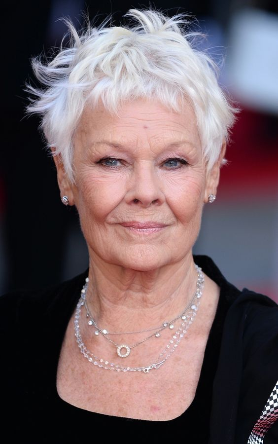 "Judi Dench, in her 80's and rockin' the do!  Stylist Matthew Shields of Sally Hershberger salon suggests in Allure Magazine that to keep this particular cut modern and youthful, ""leave the length slightly longer than a traditional pixie, and 'add a little wax or pomade just to give it texture and separation.'"""