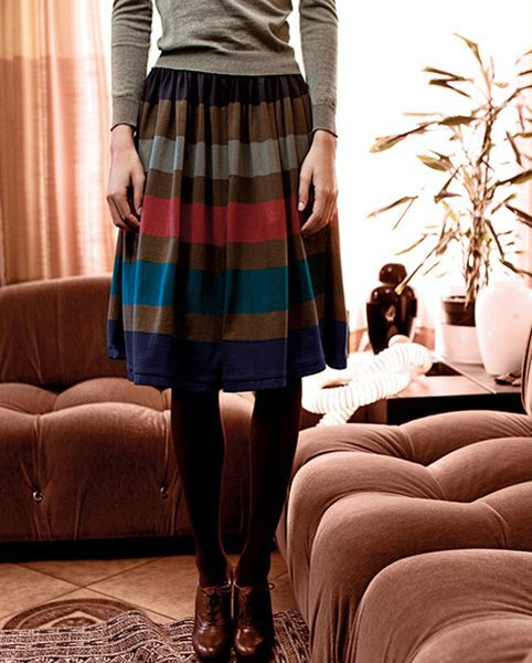 Striped skirt, tights, brown shoes, long sleeve light grey sweater...love this whole outfit