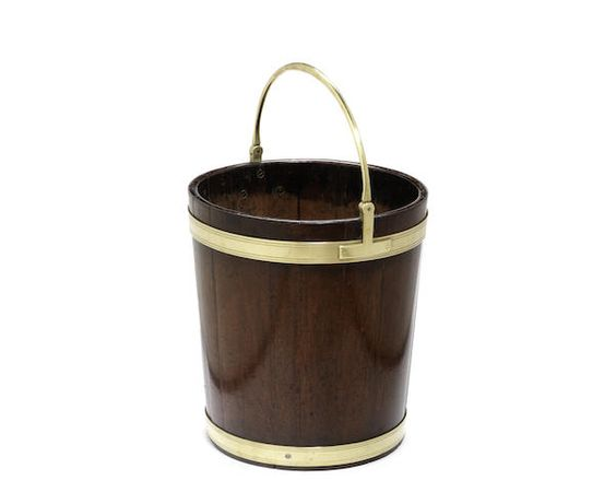 A George III mahogany and brass bound peat bucket  $2300-3400.00