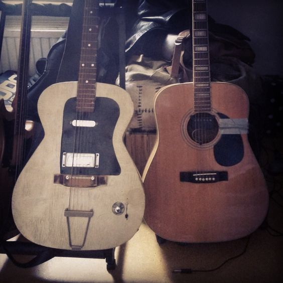 Two crappy Kay guitars. I fitted the left one with a pickguard, centre block, electronics and removed the frets.