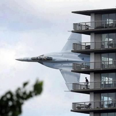 Navy F-A-18 Hornet from Oceana Naval Air Station in Virginia Flying above Detroit to entertain crowds gathered along the Detroit Rive