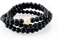 Black Onyx Wrap Bracelet with Lotus Charm and Gold Stardust by Mina Danielle