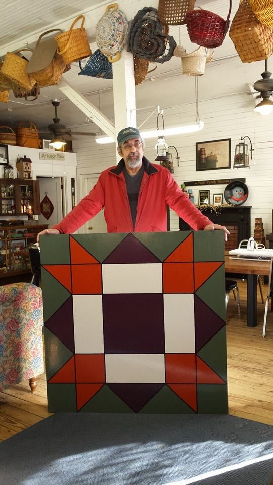 """Stephen Filarsky just finished the quilt block """"Morning"""" which will be installed at the home of Rose Bullen in Youngsville."""