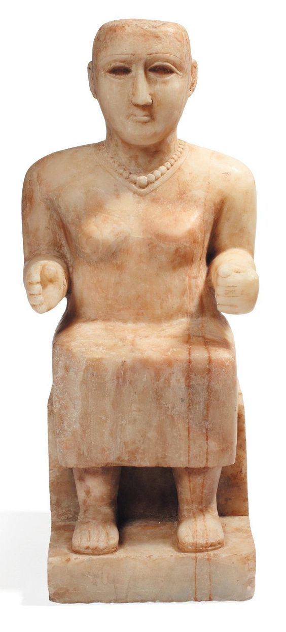 Outstanding south arabian alabaster statue of a seated wooman. Ca. 1st - 2nd…