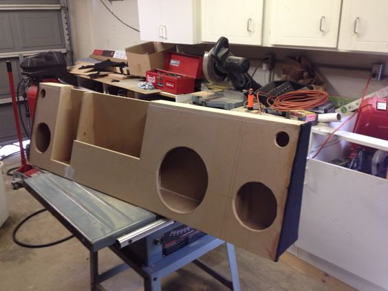 Subwoofer box with a set of separates, amp, and cubby for behind the seat of my '74 Chevy C10.