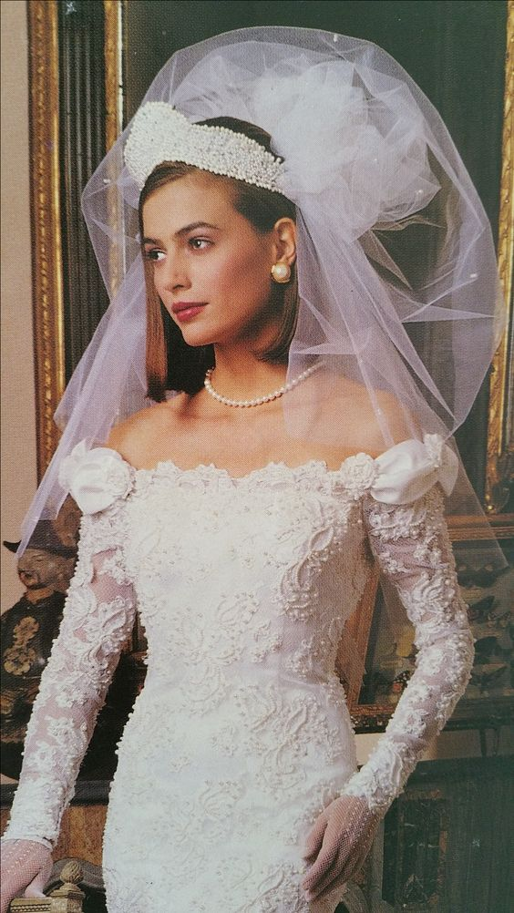 "Demetrios 1992      A full shoulder (22"") length bubble veil with an encrusted pearl Tiara."