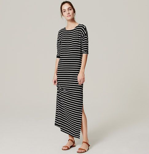 "In super soft and stretchy jersey, dropped shoulders add just the right slouch to this nautically striped maxi. Round neck. 3/4 sleeves. Side slits. 38"" from natural waist."