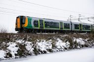 Frozen canal and snow with London Midland Train