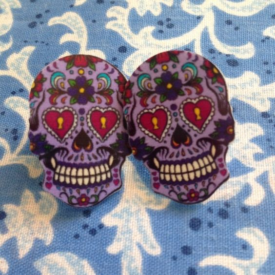 Day of the dead stud earrings Plastic with metal back. Earring backs included. Quality guaranteed or I'll replace them. Price firm unless bundled. Jewelry Earrings
