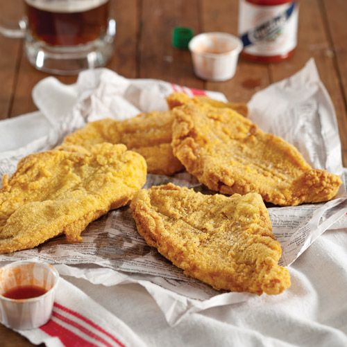 This classic Southern-Fried Catfish, dipped in buttermilk and battered in seasoned yellow cornmeal, is a delicious and authentic Southern supper.
