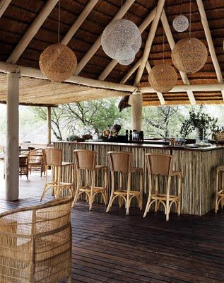 This is close to my idea of a bar under the shelter of a Tiki-esqe canopy.