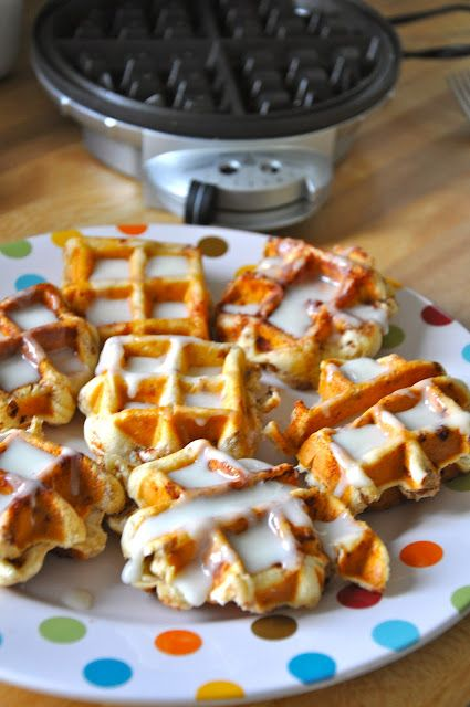 Cinnamon rolls + waffle iron -- 1 tube refrigerated cinnamon rolls. Heat waffle maker & spray w/ non-stick spray. Separate your rolls & place 1 in all 4 slots of your Belgian waffle maker, close lid & press down slightly & set timer for 2½-3 mins. Remove from waffle iron, pile on warmed plate, drizzle w/ the icing pack that comes with the pkg.