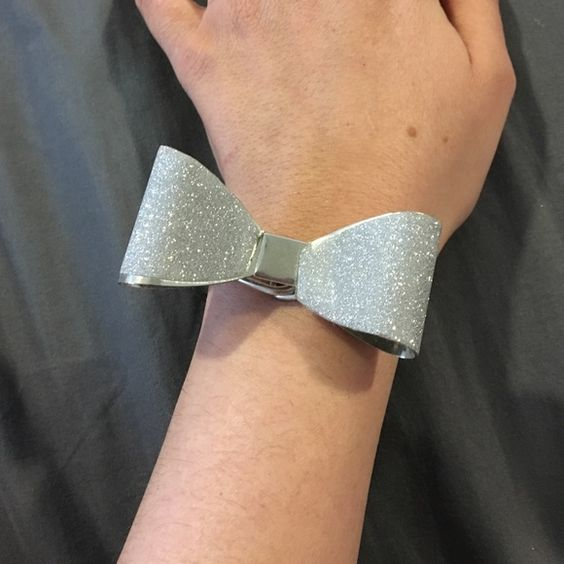 FREE w/ purchase - Glitter bow bracelet Only ONE available. FREE w/ any purchase! First purchase gets it. Silver glitter bow bracelet has never been worn. Picture 2 and 3 show how is opens and closes. Jewelry Bracelets