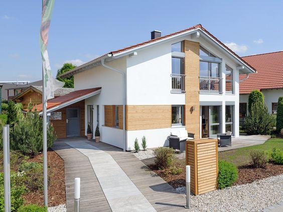 Musterhaus Poing • Effizienzhaus von ALBERT Haus • Einfamilienhaus mit offenem Wohnkonzept und klassischem Satteldach.