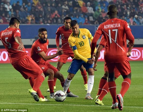 Neymar takes on a number of Peru players during Brazil's opening match in the Copa America...