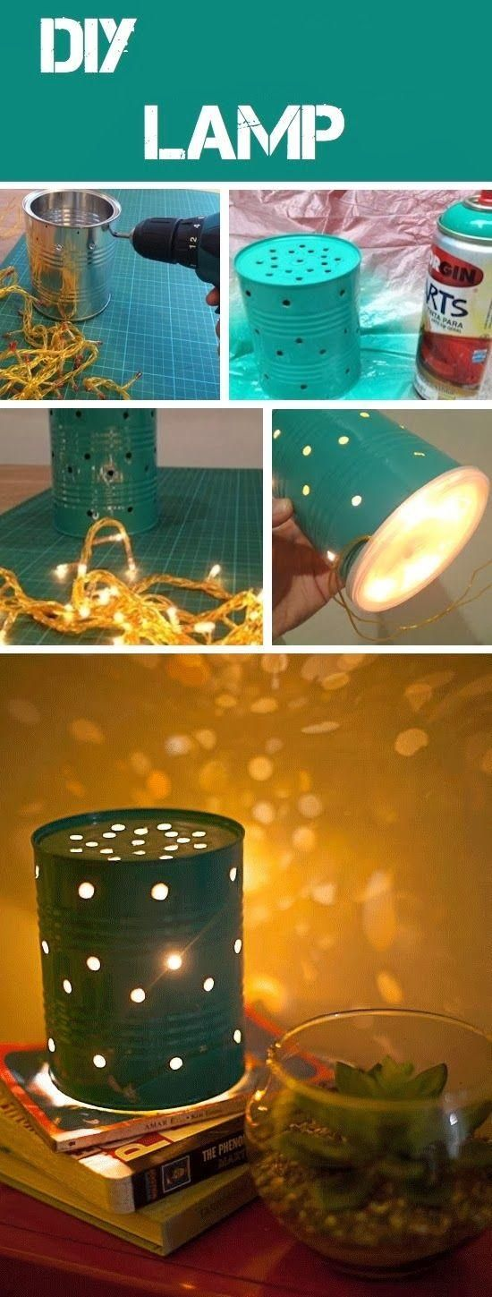 DIY Can Lamp. I think the bottom is covered with a yogurt lid? And filled with a small strand of some cheap Christmas lights?