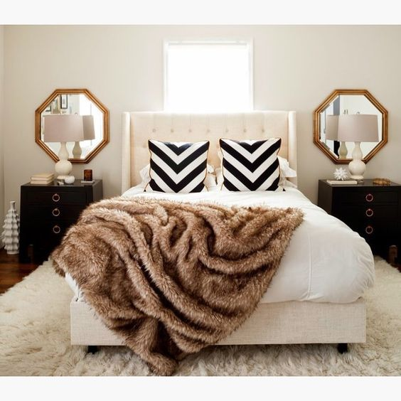 """""""By JWS Interiors"""" great idea to put mirrors above each nightstand."""