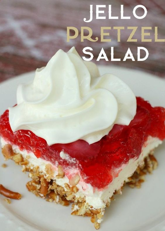 Delicious JELLO Pretzel Salad. My grandma used to always make this! Bonus Poke Cake recipe below this one :)