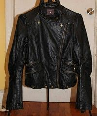 This is a gently owned black Size small leather jacket from Forever 21. It is accented with multiple