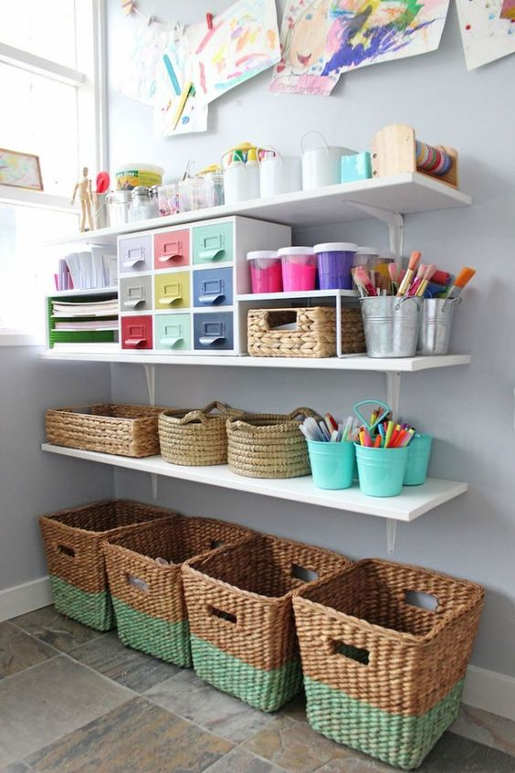 Create a gorgeous art and craft space for your kids using open shelving, wicker baskets, colourful baskets and drawers so that everything is organised but easy to find