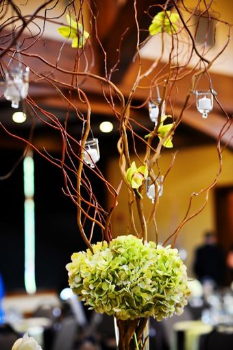 Candles hanging in branch arrangement centerpieces