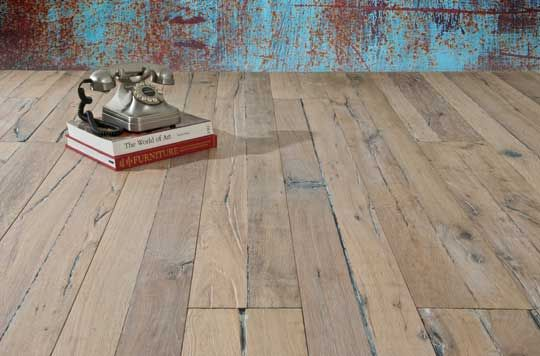 "The flooring in the photo comes from Holland-based Du Chateau, which reproduces antique hard-wax oil floors that are both high-end and eco-friendly. The company's new Heritage Timber Edition features scrapes, nail holes notches and saw kerf marks ""reminiscent of salvaged textures."""