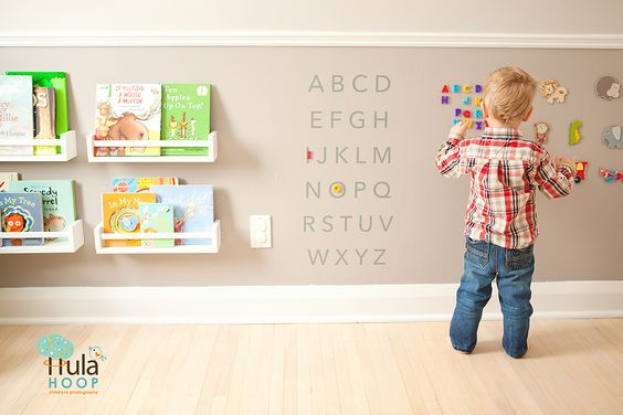 Actually found this photo on my favourite photographer's site (hulahoopphotography.com), but I LOVE what her client has done with her child's wall!! Looks like magnetic paint, and child-height bookshelves. IN LOVE!: