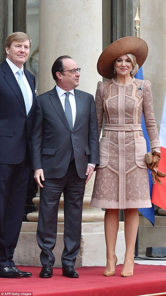 Queen Maxima towered over French President Francois Hollande.