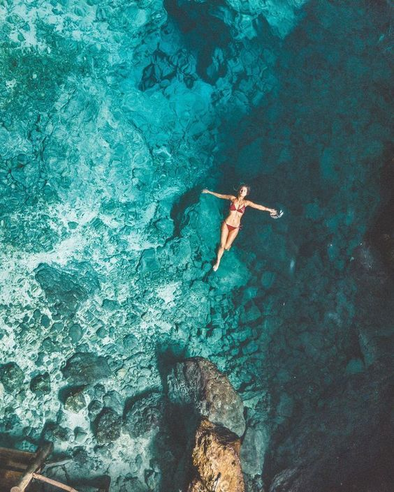 Swimming in Hoyo Azul (Blue Hole), Dominican Republic | Clear Blue Water in Punta Cana | Tropical Paradise Beach Getaways in the #caribbean | Islands Near North America #tropicalparadise #amazingplacesintheworld #dronephotographyideas #droneconcept#photoideas