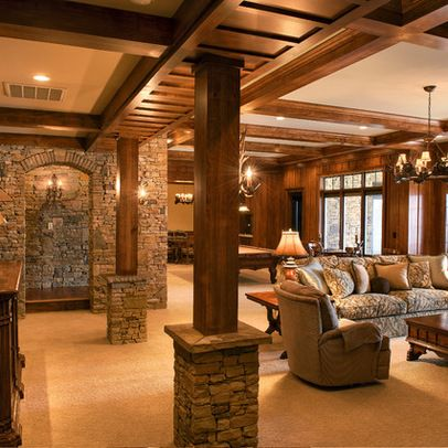 When we skip the bar and go with a living and game room you can go with wood beams and brickwork alongside your more rustic accents. This one is actually quite large and with a walkout to enjoy the outdoors too.